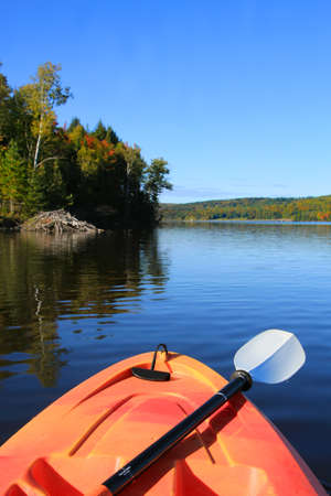 maritimes: Kayak on the Saint John River in early Autumn season with beaver dam in the background in New Brunswick, The Maritimes in Canada. Focus on front of kayak