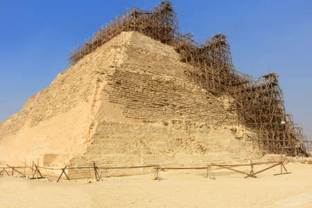 djoser: Step Pyramid of Djoser under renovation and preservation in Saqqara, Egypt Stock Photo