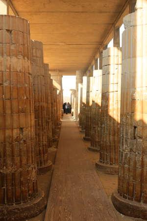 entranceway: SAQQARA, EGYPT, JANUARY 31, 2016: People visiting the ruins in the Saqqara, entering and exiting through its main entranceway with large Roman pillars along the walkway