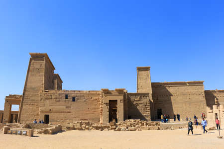 cult: ASWAN, EGYPT - FEBRUARY 1, 2016: Tourists visiting the Graeco-Roman Temple of Philae  dedicated to the cult of Isis in Egypt near Aswan Editorial