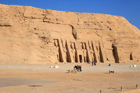 dedicated: ABU SIMBEL, EGYPT - FEBRUARY 2, 2016: Tourists visit theTemple of Hathour built by  Ramses II dedicated to his wife, Nerfertari, Abu Simbel in Egypt Editorial