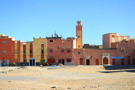 rural town: RISSANI, MOROCCO - FEBRUARY 22, 2016: Colorful houses in Rissani a rural town in Morocco Editorial