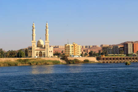 minarets: Aswan Mosque along the Nile River with two minarets Stock Photo