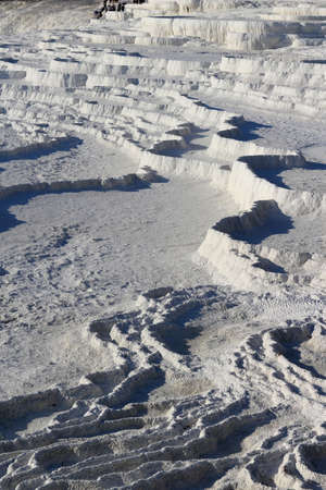 hots: White travertine terraces made from the hots springs leaving deposits of calcium  at Pamukkale or Cotton Castle