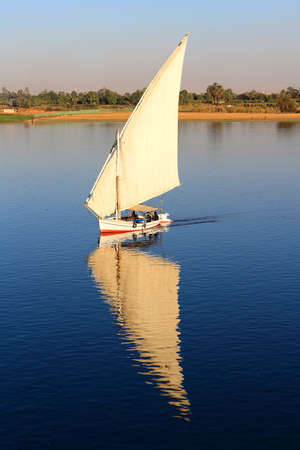white nile: Felluca with white sails, sailing along the Nile River in Egypt