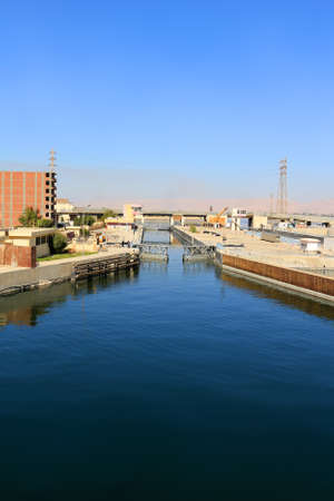 nile river: Approaching the Ship locks in Esna, and old dam on the Nile River, Egypt Editorial