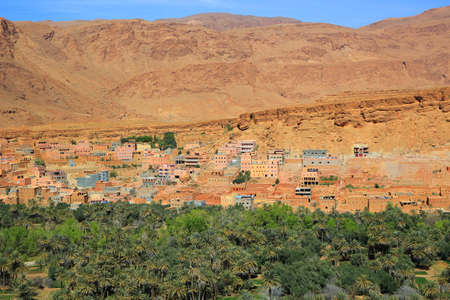 ochre: Moroccan  village on the Eastern slopes of the Atlas Mountains at Tinerhir oasis