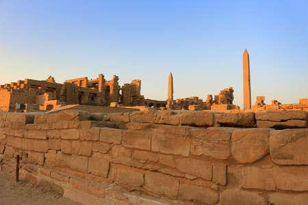 obelisk stone: Obelisks and ancient Egyptian ruins  in the temple of Karnak in Luxor Egypt, Africa at sunset