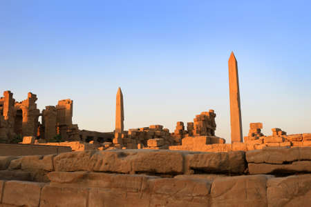 Obelisks with ancient Egyptian hieroglyphics in the temple of Karnak in Luxor Egypt, Africa at sunset Stock Photo