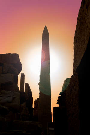 obelisk stone: Silhouetted Obelisk with ancient Egyptian hieroglyphics in the temple of Karnak in Luxor Egypt, Africa at sunset