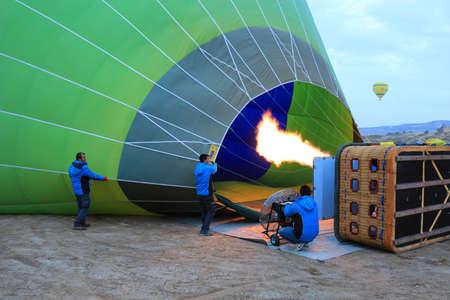 fill up: Cappadoccia, Turkey: Men fill up hot air balloon in the early morning at Cappadoccia, Turkey on February 17th, 2016