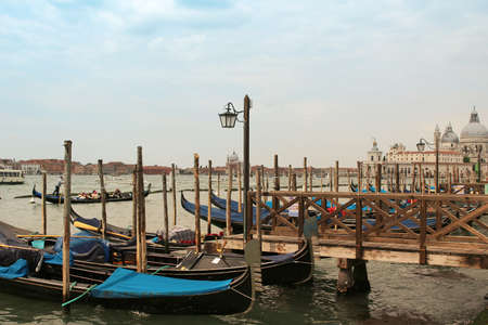 gondoliers: June 20,2015 - Venice Italy :Gondoliers and Boats in Venice  on the Bacino di San Marco, Italy
