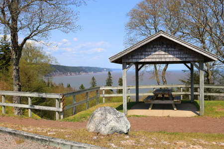 shorelines: Unspoiled landscape with picnic table overlooking the Bay of Fundy on the Fundy Trail Parkway in New Brunswick, Canada