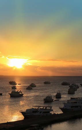 docked: Boats docked in Hurghada Egypt during sunset on the Red Sea Stock Photo