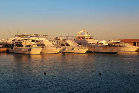 hurghada: Yachts  on the Red Sea in Hurghada, Egypt at sunset Stock Photo
