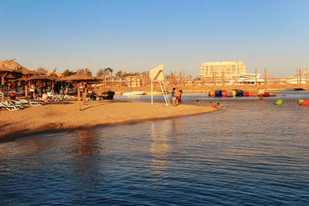 Hurghada, Egypt - Feb. 2, 2016: beach area with sun shades and lounging chairs at a resort on the Red Sea in Hurghada, Egypt Editorial