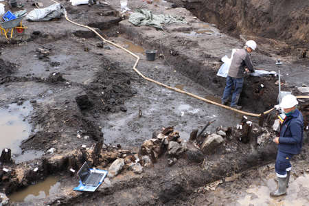 findings: Odense, Denmark - October 3, 2016: Street being dug up with historical findings being tagged by archaeologists on site in Odense, Denmark, Scandinavia Editorial