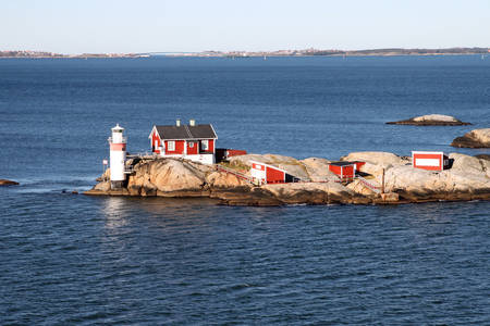 archipelago: Lighthouse and red buildings on small rocky island in the archipelago on the North Sea at Gothenburg, Sweden in Scandinavia Stock Photo