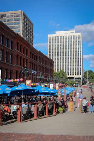 maritimes: Saint John, New Brunswick - August 18, 2016: People enjoying the summer along the Market Square Boardwalk in downtown Saint John New Brunswick in the Maritimes, Canada Editorial