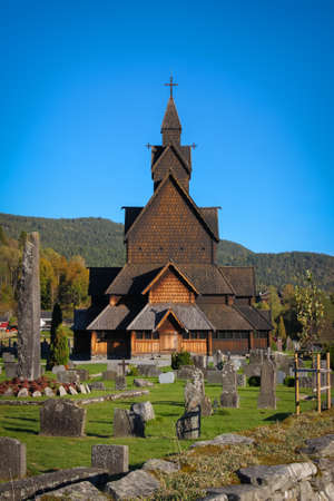 religious building: Beautiful structure of Heddal stave church made of wood in the countryside of  Notodden, Telemark, Norway