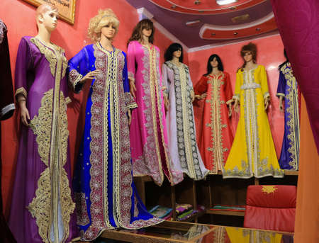 ceremonial clothing: Bursa, Turkey - February 28, 2016: Mannequins in the Covered Bazaar with beautiful colorful gowns in the cental market in Bursa, Turkey