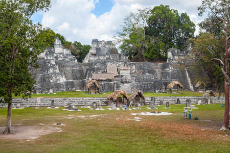 Tikal, Guatemala - March 2, 2017: Pleople visit the Acropolis in Gran Plaza in Mayan city of  Tikal, Guatemala