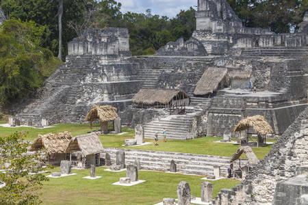 treetops: Tikal, Guatemala - March 2, 2017: Pleople visit Temple in Gran Plaza in Mayan city of  Tikal, Guatemala Editorial