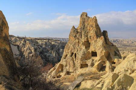 monastic: Beautiful rock formations with windows and doorways called the Girls Monastery   in Goreme, Cappadocia  Anatolia, Turkey