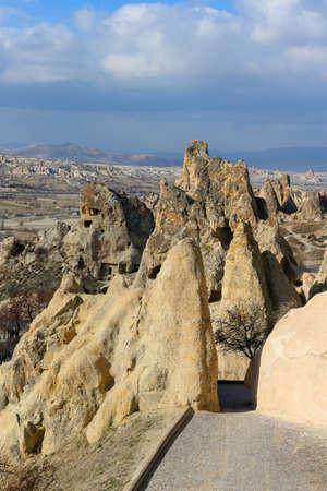 monastic: Beautiful rock formations with windows and doorways  in Goreme, Cappadocia  Anatolia, Turkey