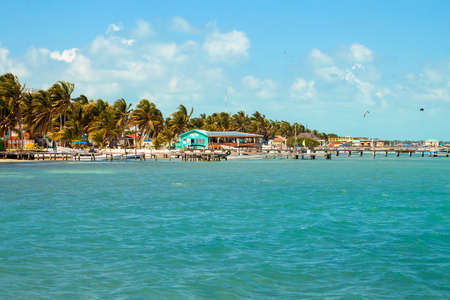 Beautiful tropical shoreline  with piers for boats on the  island of Caye Caulker on the Barrier Reef in the Caribbean Sea