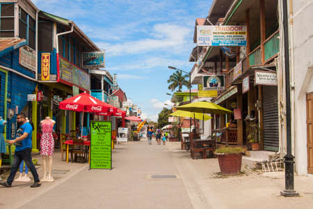 verandas: San Ignacio, Belize, March 1 2017: Main tourist street Burns Avenue with restaurants, souvenir shops and tours in the city of San Ignacio, Belize in Central America