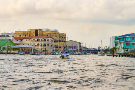 Belize City, Belize -  February 26, 2017: Waterway along the shore at the port of Belize City in the Caribbean Sea
