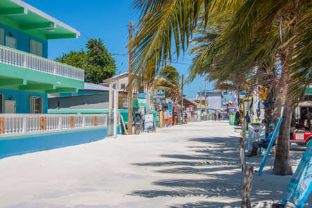 Caye Caulker, Belize - February 28, 2017: Beautiful tropical street with shops on the  island of Caye Caulker on the Barrier Reef in the Caribbean Sea Editorial