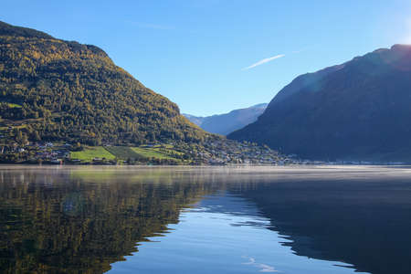 water town: Mountains and town along Sognefjord, Norway, Scandinavia with reflections on the water