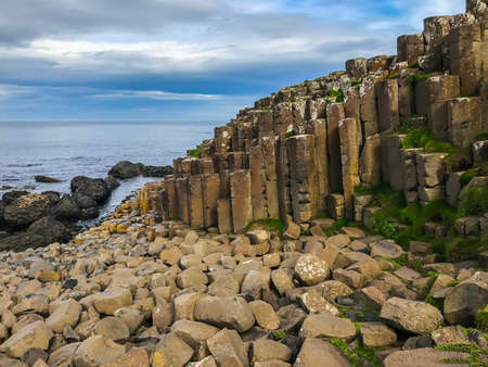 Beautiful scenery with basalt columns sticking out of the ground at Giants Causeway in Northern Ireland in the county of Antrim in the United Kingdom, Europe Stock Photo