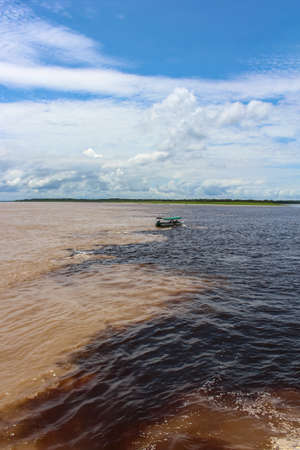 Meeting of the Waters of Rio Negro and the Amazon River or Rio Solimoes near Manaus, Amazonas, Brazil in South America Reklamní fotografie