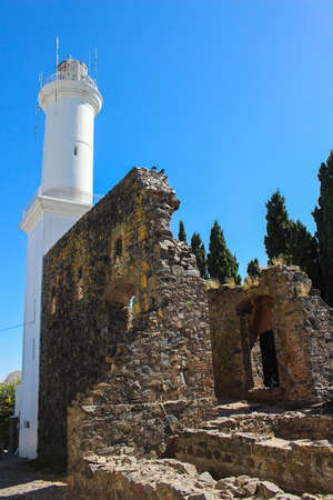 Lighthouse and ruins in the old part of town or historic quarter of Colonia Del Sacramento , Uruguay, South America