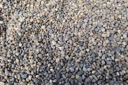 Detailed photo of beautiful pebbles near to sea cost line Stock Photo