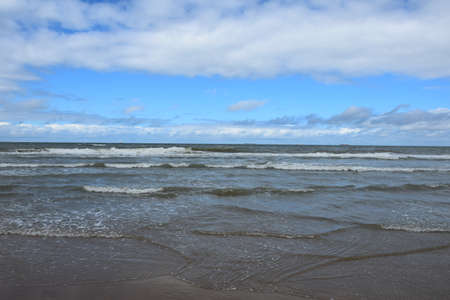 Photo of view on sea from the sandy coast in clear day Stock Photo
