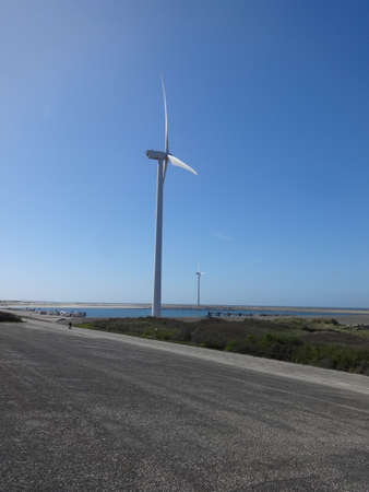 Photo of wind turbine on a coast in a clear day