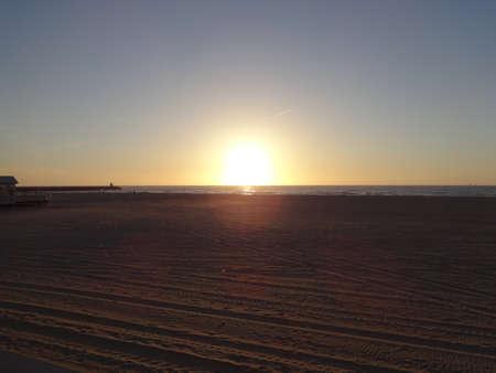 Photo of sunset over the sea coast, filmed from the coast Stock Photo