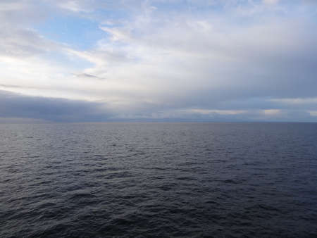 Photo of sea with horizon line, photo made from the ship