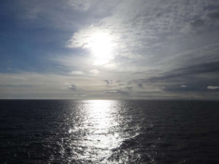 Photo of sunrise over the sea, flmed from the ship Stock Photo