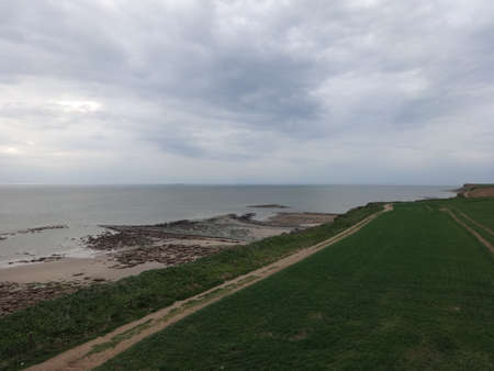 Photo of beautiful view on sea coast, filmed in overcast weather during low tide