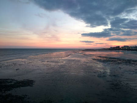 Photo of sunset over the sea coast, filmed from the Pier