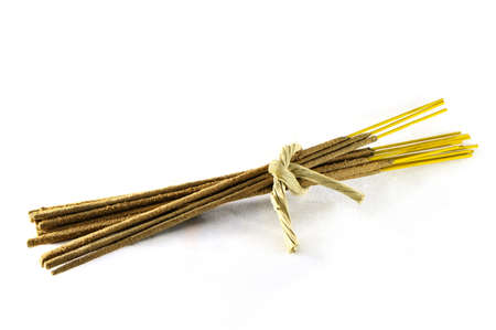 incense sticks tied in a bundle with a string of raffia Stock Photo