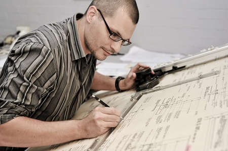 an architect looking over a plan Stock Photo - 12345839