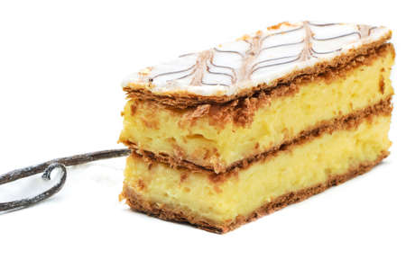 vanilla slice, custard slice, isolated on white, with vanilla bean on the side