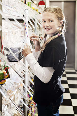 sweet shop: a young girl in a sweet shop, all logos removed