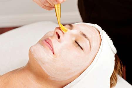 beautician: woman relaxing during a facial treatment